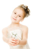 Beautiful girl in white dress with a flower Royalty Free Stock Photography