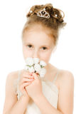 Beautiful girl in white dress with a flower Stock Photos