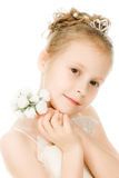 Beautiful girl in white dress with a flower Stock Image