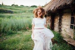 Beautiful girl in white dress lies in green grass Stock Photo