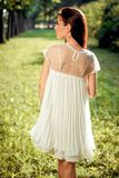Beautiful girl in a white dress on nature Stock Image