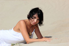 Beautiful girl on the sand hill Royalty Free Stock Images