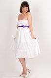 Beautiful girl in white dress with purple ri Royalty Free Stock Photography