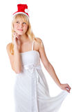Beautiful girl in white dress and santa hat Royalty Free Stock Image