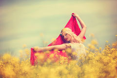 Beautiful girl in white dress in spring field, concept freedom. Beauty girl outdoor enjoying nature, beautiful model in white dress in spring field, concept Stock Images