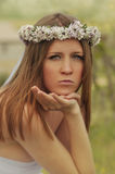 Girl in a white dress. Beautiful girl in a white dress with a wreath on her head Royalty Free Stock Photo