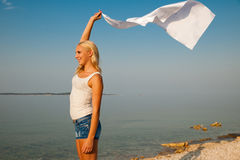 Beautiful Girl With White fabric on The Beach. Travel and Vacati Royalty Free Stock Image