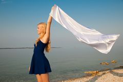 Beautiful Girl With White fabric on The Beach. Travel and Vacation. Freedom Concept... Beautiful Girl With White fabric on The Beach. Travel and Vacation stock photo