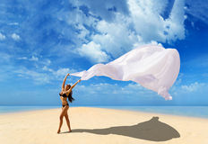Beautiful Girl With White fabric on The Beach. Royalty Free Stock Image