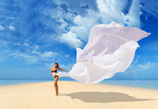 Beautiful Girl With White fabric on The Beach. Royalty Free Stock Photos