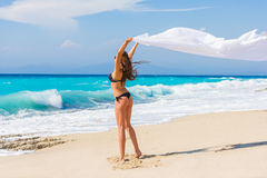 Beautiful Girl With White fabric on The Beach. Stock Photography