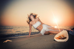 Beautiful Girl With White fabric on The Beach. Royalty Free Stock Images