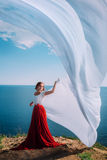 Beautiful Girl With White fabric on sea background Royalty Free Stock Photos