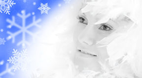 Beautiful girl with white feathers Stock Image