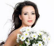Beautiful girl with white flowers Royalty Free Stock Images