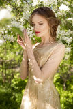 The beautiful girl and white flowers of the blossoming apple-tre Stock Image