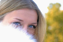 The beautiful girl in a white fur coat Royalty Free Stock Images