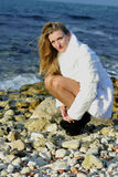 The beautiful girl in a white fur coat Stock Photos