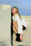 The beautiful girl in a white fur coat Royalty Free Stock Photo