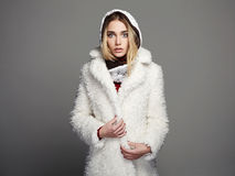 Beautiful girl in white fur coat and hood. winter fashion Stock Photos