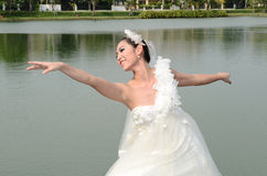 Beautiful girl in white gown of the bride dance Royalty Free Stock Photo