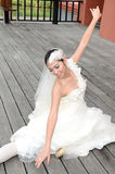 Beautiful girl in white gown of the bride dance Royalty Free Stock Photography