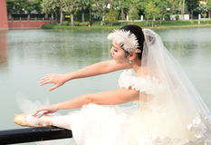 Beautiful girl in white gown of the bride dance Stock Photography