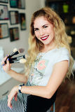 Beautiful girl with white hair with brushes in her hands, profession of make-up artist Royalty Free Stock Photos