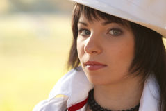 Beautiful girl in the white hat Royalty Free Stock Photography