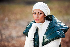 Beautiful girl in white hat and gloves posing. Outdoor stock images