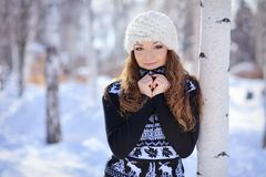 Beautiful girl in white hat stands near the birch  Royalty Free Stock Image
