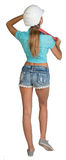 Beautiful girl in white helmet, shorts and shirt Royalty Free Stock Image