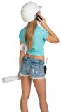 Beautiful girl in white helmet, shorts with shirt Stock Photo
