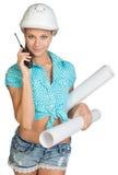 Beautiful girl in white helmet, shorts with shirt Stock Photo