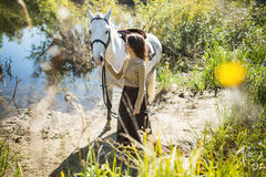 Beautiful girl with the white horse Stock Photos
