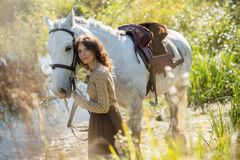 Beautiful girl with the white horse Stock Images