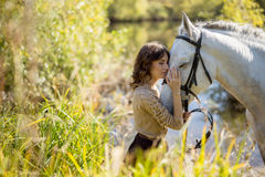 Beautiful girl with the white horse Royalty Free Stock Photos