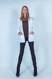 Beautiful girl in a white jacket and trousers Stock Photo
