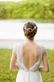 Beautiful girl in white long dress with open back. Beautiful slim girl in white long dress with open back Stock Images