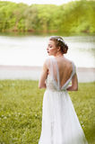 Beautiful girl in white long dress with open back Royalty Free Stock Image