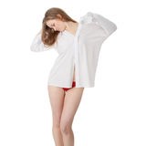 The beautiful girl in a white men shirt Stock Image