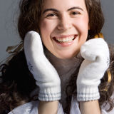 Beautiful girl in white mittens. Stock Photography