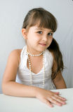 Beautiful girl with white pearl bead Stock Image
