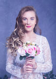 Beautiful Girl in a white peignoir with a bouquet of flowers Royalty Free Stock Photography