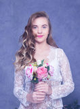 Beautiful Girl in a white peignoir with a bouquet of flowers Royalty Free Stock Photos