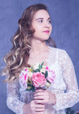 Beautiful Girl in a white peignoir with a bouquet of flowers Stock Photography