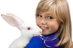 The beautiful girl with a white rabbit Stock Photos
