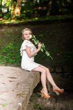 Beautiful girl with white rose Stock Photos