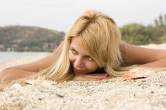Beautiful girl on white sand stock photography