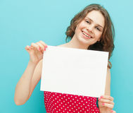 Beautiful girl with a white sheet of paper Royalty Free Stock Photography